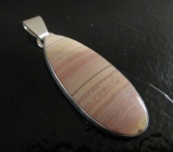 Rainbow dolomite and sterling silver pendant handmade by Dale Repp in Lone Tree, Iowa