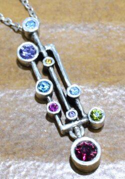 Patricia Locke Rain Dance necklace pendant close-up