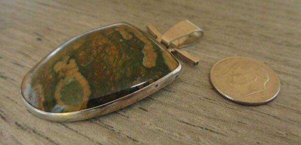 rainforest jasper pendant with dime for size