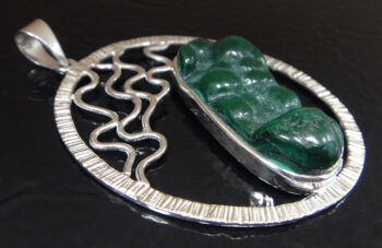 Raw malachite and sterling silver pendant close up