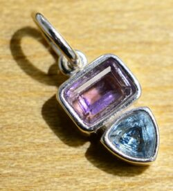 This sterling silver blue topaz and amethyst pendant is handmade by Sonoma Art Works.