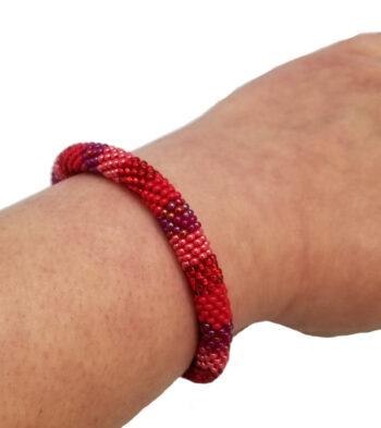 red roll-on bracelet on wrist