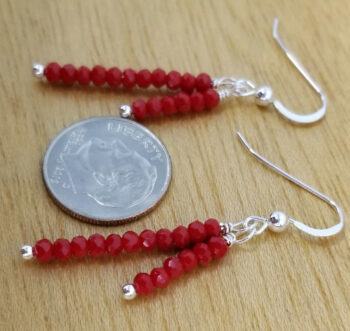 red art glass earrings with dime for scale