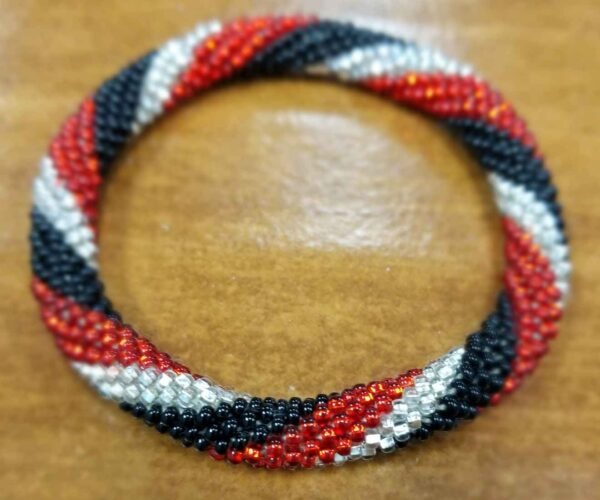 red, black, and silvertone Czech glass seed bead roll-on bracelet