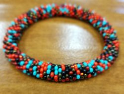 red, blue, black, and bronze roll-on Czech glass bracelet