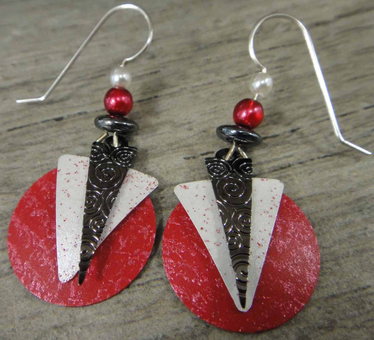 These red, white and black dangle earrings are handmade by Adajio.