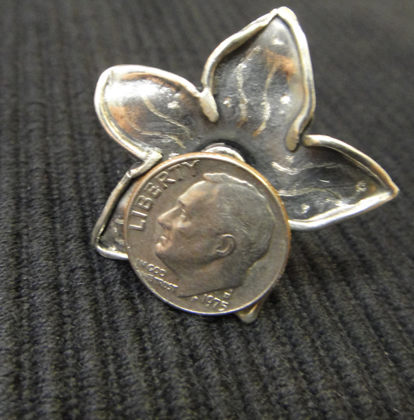 red cubic zirconia flower ring with dime for scale
