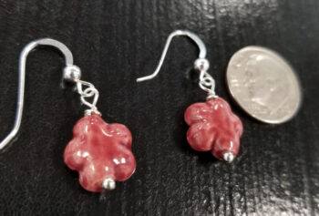 back of red daisy earrings with dime for scale