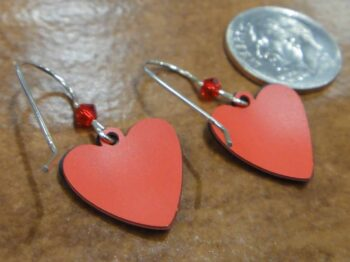 back of music notes and red heart earrings with dime
