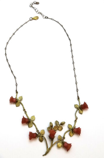 red rose necklace on white background
