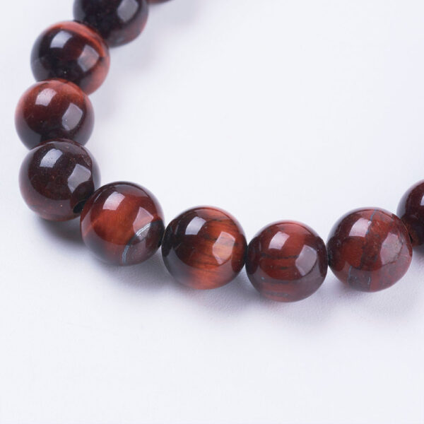 close up of red cherry tiger's eye beads, used in bracelet