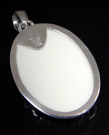 back of resin skeleton cameo pendant