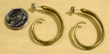 side view of Michael Michaud handmade bronze rice hoop earrings with dime
