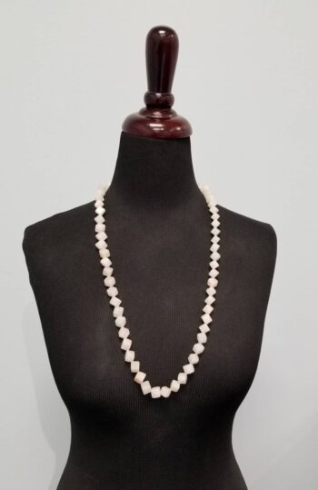 long necklace on mannequin