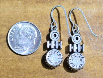 back of Rosie silver tone earrings by Patricia Locke with dime for size