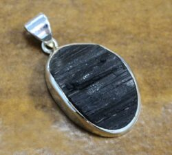Rough black tourmaline and sterling silver pendant