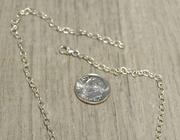 Adjust this necklace by clipping the clasp in any of the large silver rings
