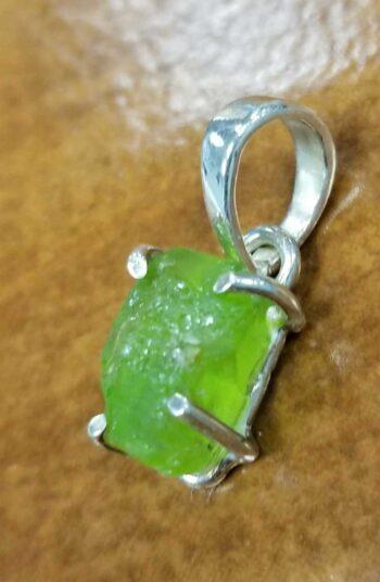 side of rough peridot druzy pendant