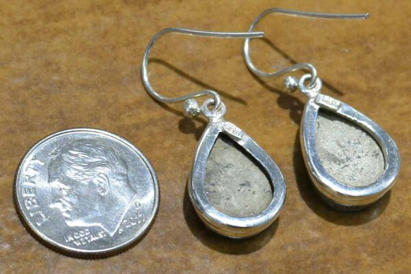 back of handmade rough pyrite and sterling silver drop earrings with dime for size