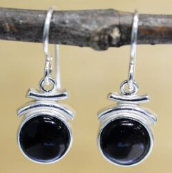 These petite black onyx and sterling silver dangle earrings are handmade by Sonoma Art Works.
