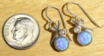 These created opal and pearl earrings are handmade by Sonoma Art Works (pictured with dime for scale).
