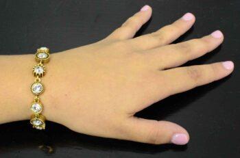 Round Two gold tone bracelet by Patricia Locke modeled on wrist