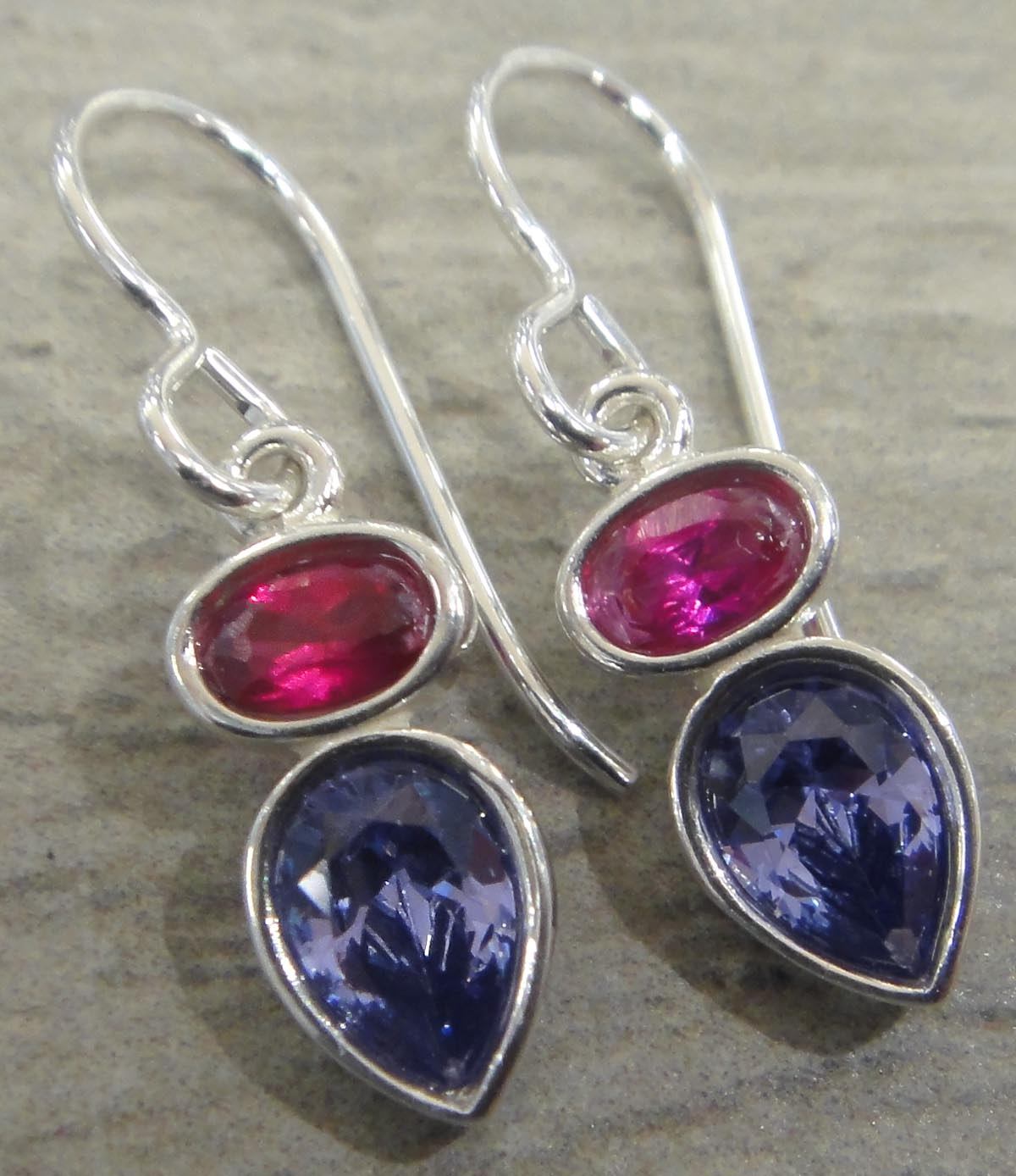 These sterling silver ruby cubic zirconia and tanzanite cubic zirconia earrings are handmade by Sonoma Art Works.