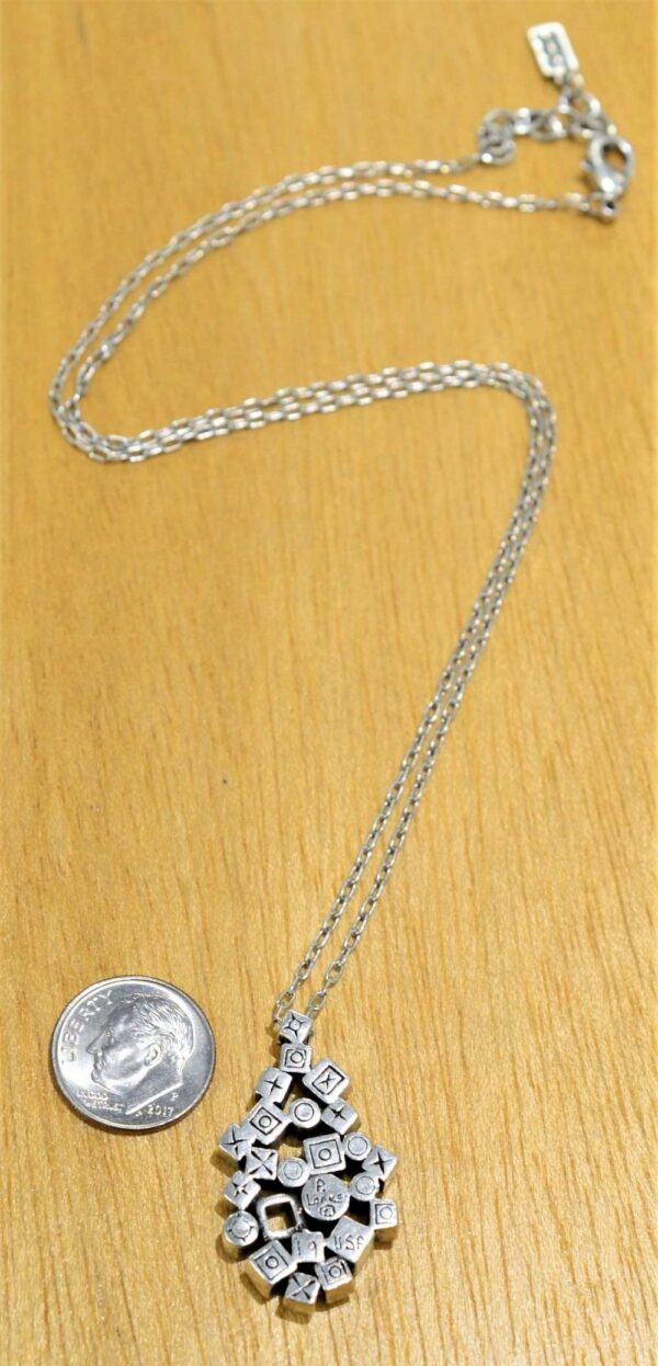 Patricia Locke Scatterplot silvertone necklace style in All Crystal, back view, shown with dime (not included) for scale