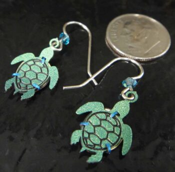 Back of sea turtle earrings made by Sienna Sky with dime for scale