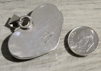 back of seraphinite heart pendant by Dale Repp with dime