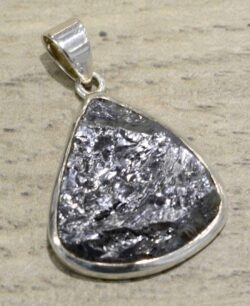 handmade silicon and sterling silver pendant