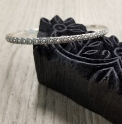 handmade sterling silver bangle bracelet with daisy design