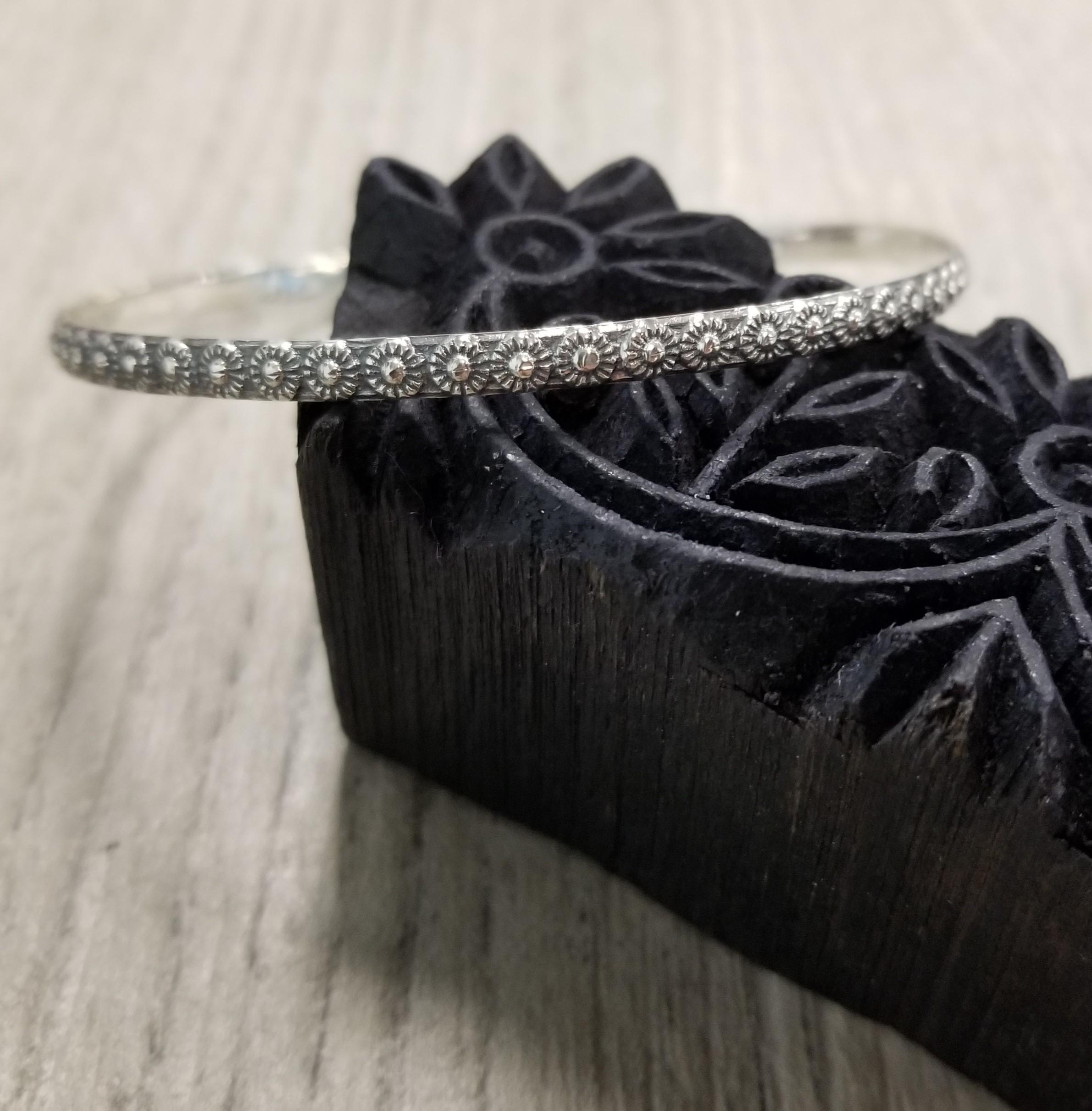 handmade sterling silver bangle bracelet with daisy design