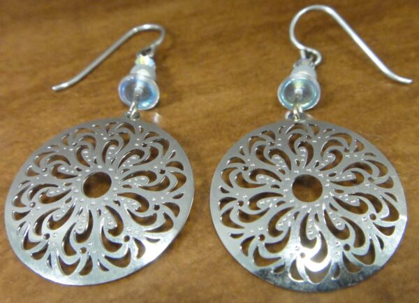 These silver-tone filigree circle dangle earrings are handmade by Adajio.