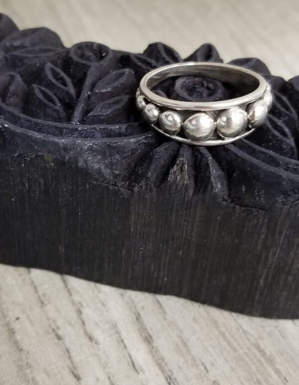 sterling silver ring on woodblock