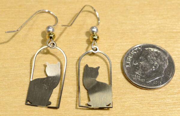 Back of silvertone cat in frame earrings