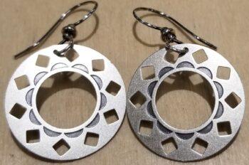 silver-tone circle earrings by Joseph Brinton