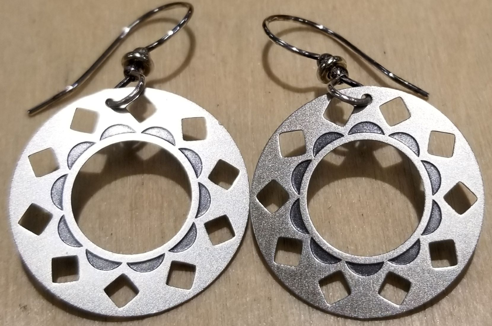 silver-tone circle earrings by Joseph Brinton