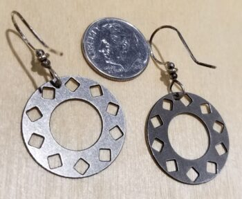 back of silver-tone circle earrings with dime for scale