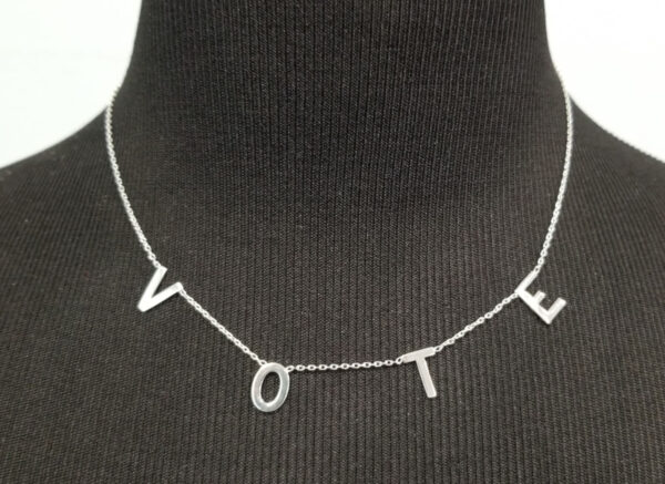 sterling silver vote necklace on dress form