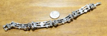 back of Singin' in the Rain bracelet by Patricia Locke with dime for size