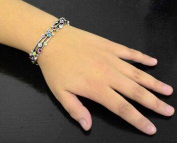Singin' in the Rain bracelet by Patricia Locke modeled on wrist