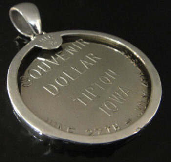back of Tipton, Iowa souvenir coin pendant