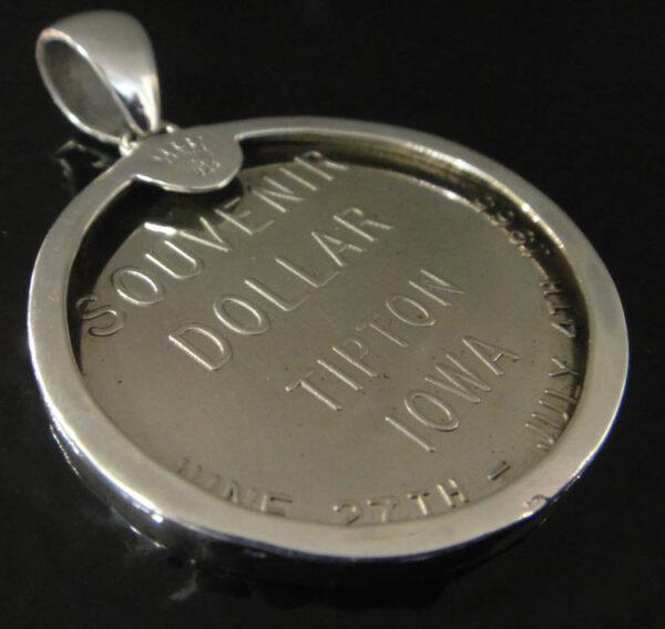 back of Tipton, Iowa souvenir coin pendant