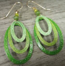 These sparkly green oval earrings are handmade by Adajio.
