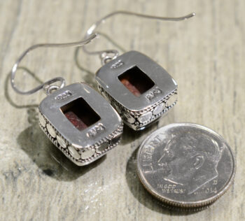 back of handmade rectangle spiny oyster shell earrings with dime