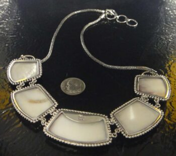 back of spiny oyster shell sterling silver necklace with dime for scale