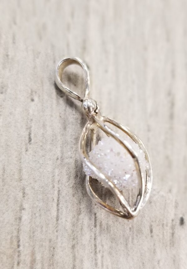 rough spirit quartz crystal and sterling silver cage pendant
