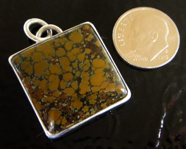 brown turquoise square pendant by Dale Repp with dime for size