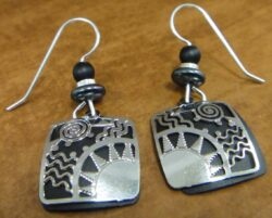black and silvertone sun design Adajio earrings